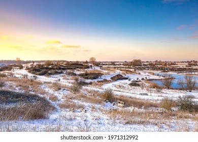 Snowy landscape with hills and meadows under a blue sky in Winter season. Buytenpark Zoetermeer, the Netherlands