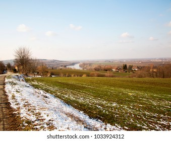 Snowy landscape with river on the background, horizontal image
