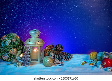 Snowy Lantern with Fir Branches And Baubles on Christmas banner