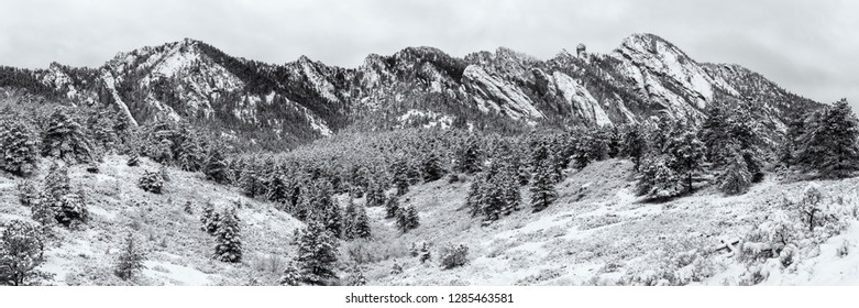 A snowy morning on Bear Peak and Shadow Canyon seen from the Mesa Trail in the Flatiron Mountains of South of Boulder, Colorado.