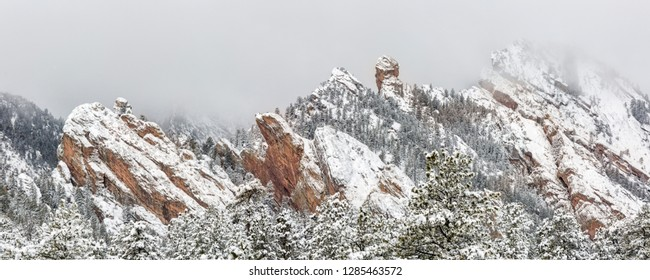 A snowy morning on the Mesa Trail in the Flatiron Mountains of South of Boulder, Colorado.