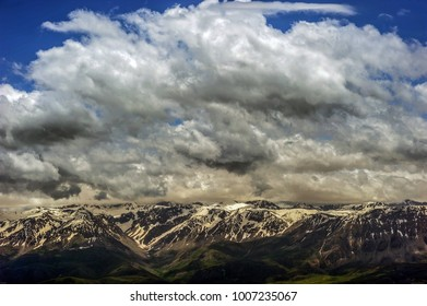 Snowy mountain and clouds.
