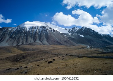 Snowy mountain cluster near the red hill