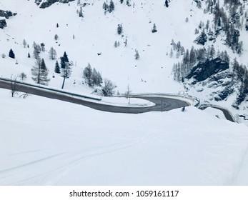 Snowy mountain pass winding road