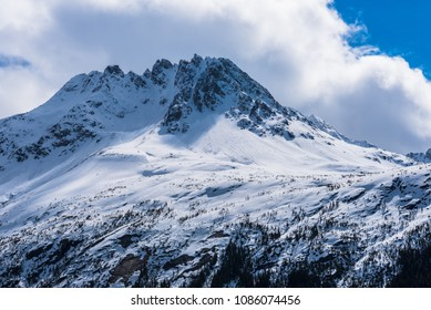 A snowy mountain peak along the Yukon Pass in Skagway Alaska