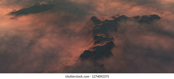 Snowy mountain peaks in clouds at sunrise. Aerial view.