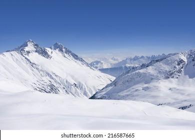Snowy mountain range and blue sky