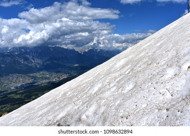 Snowy mountain side with view over Innsbruck