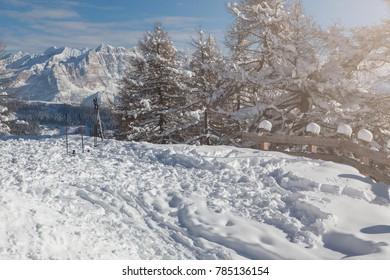 Snowy mountain ski background on sunny day