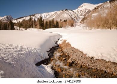 Snowy mountain stream