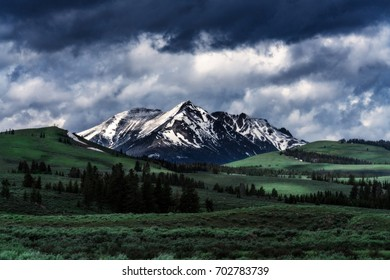 Snowy Mountain under Stormy Clouds