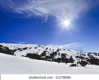 snowy mountains Australia sunny day with cloud winter nature landscape over snow and rocks at ski resort