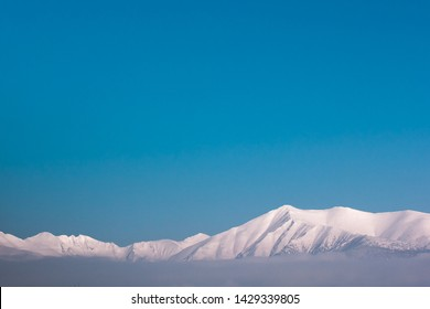 Snowy mountains and blue sky - Shutterstock ID 1429339805