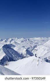Snowy mountains. Caucasus Mountains, Georgia, view from ski resort Gudauri.