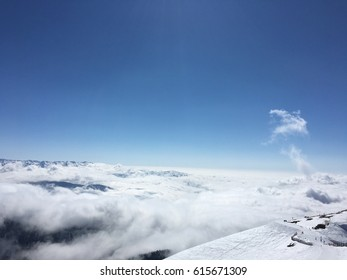 snowy mountains in the clouds