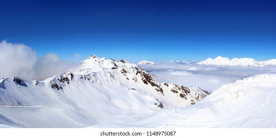 Snowy Mountains in the clouds blue sky