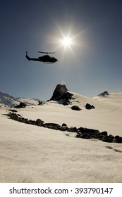 snowy mountains and helicopters