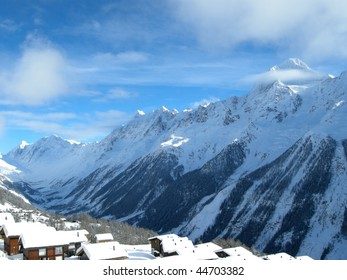 Snowy mountains and huts in the Alps, Skiing