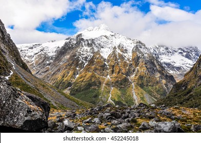 Snowy mountains in the Milford Road, one of the most beautiful scenic roads in New Zealand