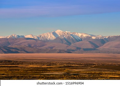 snowy mountains, Mongolian steppe, Altai mountains, Altai Republic, mountains on the background of the steppe, dawn in the mountains