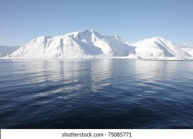 Snowy mountains at Norwegian coast