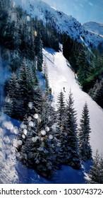 Snowy mountains panorama, ski slope, Austrian Alps
