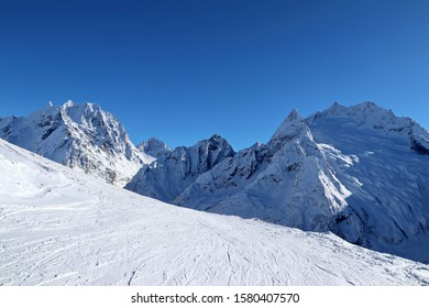 Snowy Mountains peaks and the blue sky Caucasus