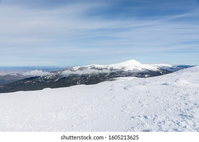 Snowy mountains in the Sierra de Guadarrama of Madrid seen from the ascent to Guarramillas