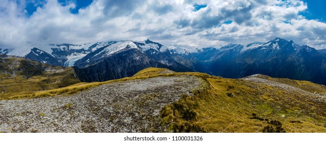 snowy mountains and yellow grass. Cascade Saddle,Mt.Aspiring National Park, New Zealand