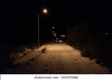 Snowy path with lone lampost