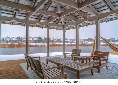 Snowy patio of a clubhouse overlooking Oquirh Lake