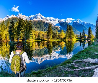 Snowy peaks of the Alps are beautifully reflected in the lake. Picturesque park in the mountain resort of Chamonix, at the foot of Mont Blanc. Concept of active and ecotourism