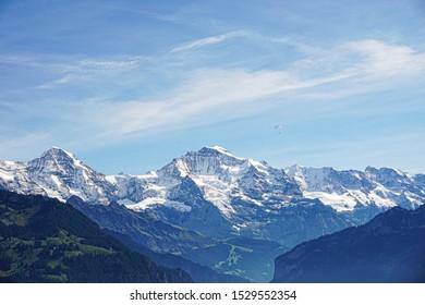 Snowy peaks of Jungfrau against a bright, blue sunny sky.