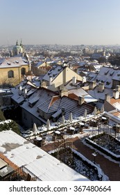 Snowy Prague City with St. Nicholas' Cathedral  in the sunny Day, Czech Republic