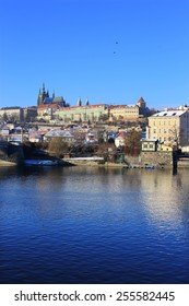 The snowy Prague gothic Castle above the River Vltava, Czech Republic