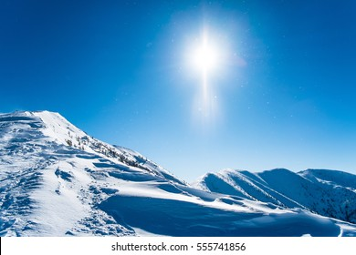 Snowy ridge of mountains, Background winter mountains alps, European snowy landscape with sun, Intact winter landscape for freeride skiing