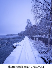 Snowy river landscape from Kuhmo, Finland.