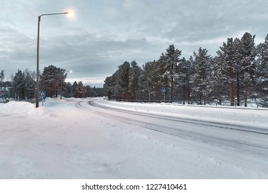 Snowy road in the soft glow of nordic polar night