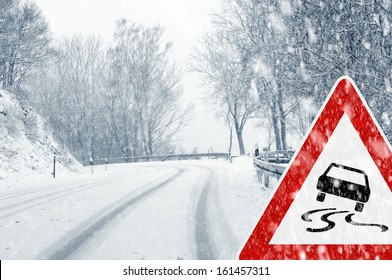 Snowy road with traffic sign  Sudden and heavy snowfall on a country road. Driving on it becomes dangerous �