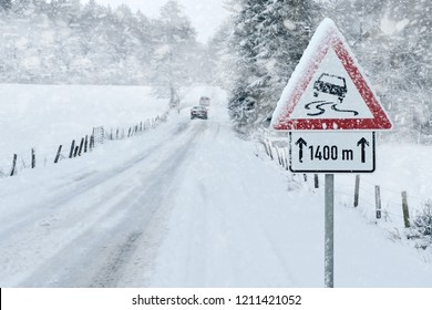 Snowy Road with Warning Sign