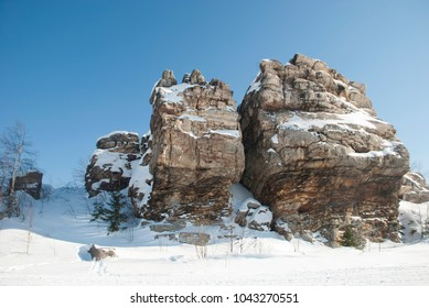 Snowy rocks and blue sky