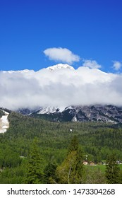 Snowy and rocky mountain at Dolomiti (Dolomites) range with cloudy blue sky -Cortina d'Ampezzo located in Veneto,Italy