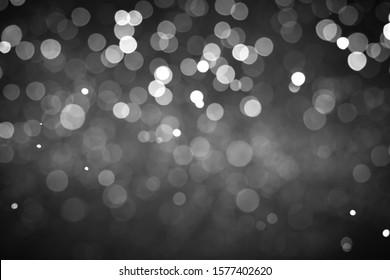 Snowy shiny bokeh isolated on black background