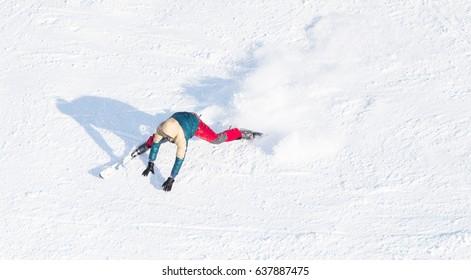Snowy ski slopes of Pradollano ski resort in the Sierra Nevada mountains in Spain with skier in half pipe
