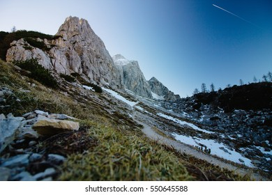 Snowy slope with a hiking path in winter