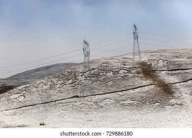Snowy slopes with electric pylon