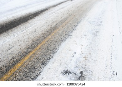 Snowy and slushy road viewed from the side