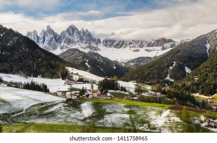 Snowy spring in Santa Maddalena (St Magdalena) village with magical Dolomites mountains in background , Val di Funes valley, Italy, Europe