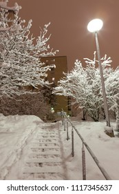 Snowy stairs outside at winter night
