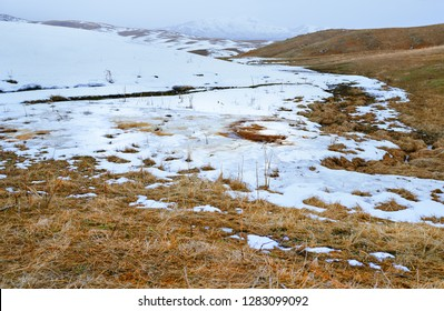 Snowy steppe at the mountains